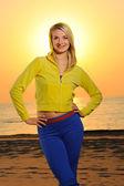 Beautiful woman on a beach at sunset — Stock Photo