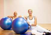 Group of doing fitness exercise with a ba — Stock Photo
