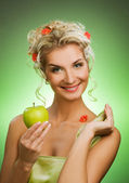 Young woman with ripe green apple — Stock Photo