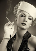 Beautiful smoking woman. Retro portrait — Stock Photo