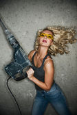 Beautiful blond woman with perforator — Stock Photo