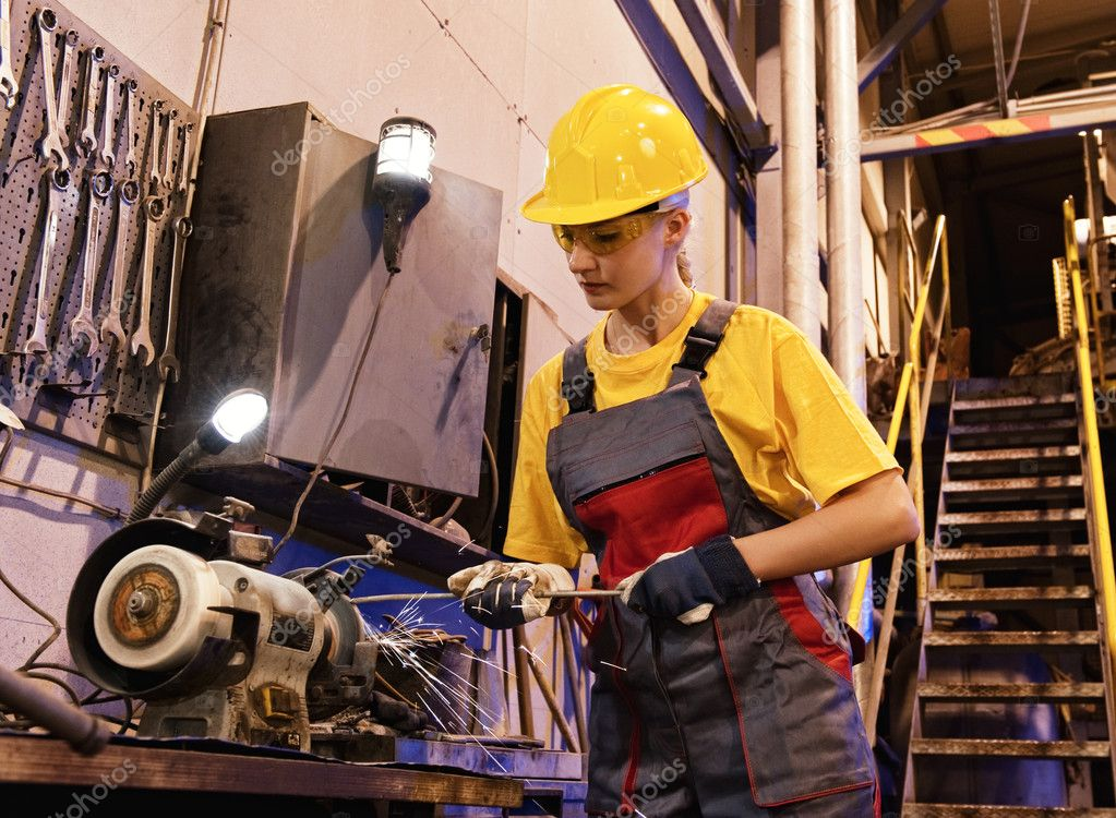 Factory female worker sharpening tools  Stock Photo #1740588