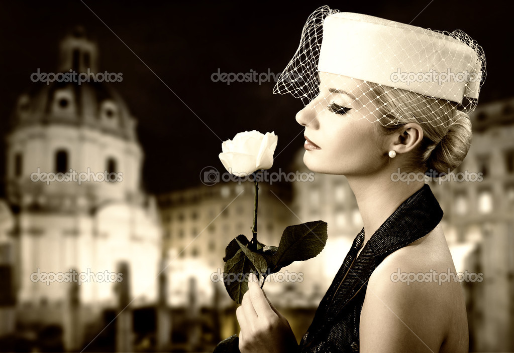 Beautiful young woman with  rose. Retro portrait — Stock Photo #1741541