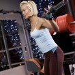 Strong beautiful woman lifting heavy weights — Stock Photo #2082293