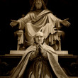 Sculpture of Jesus and prayer - Photo