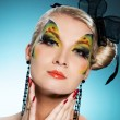 Стоковое фото: Young beauty with butterfly face-art