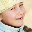 Happy toothless girl outdoors — Stock Photo
