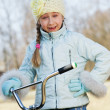 Little girl riding bicycle outdoors — Stock Photo