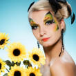 Young beauty with butterfly face-art — Stock fotografie