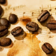 Coffee beans on a musical background - Stock Photo