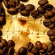 Coffee beans on a grungy musical background — Stock Photo #2082791