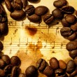 Stock Photo: Coffee beans on a grungy musical background