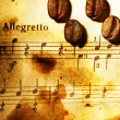 Coffee beans on a musical background — Stock Photo #2082872