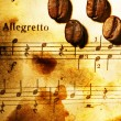 Stock Photo: Coffee beans on a musical background