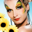 Young beauty with butterfly face-art — Stockfoto