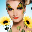 Beauty with butterfly face-art — Stockfoto