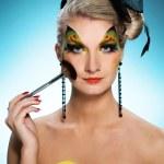 mooie vrouw met vlinder gezicht-art — Stockfoto #2083491
