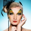 Beautiful woman with butterfly face-art — Stock Photo