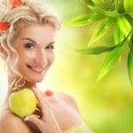 Beautiful woman with ripe green apple — Stock Photo #2083970