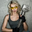 Sexy blonde with big metal hammer — Stock Photo