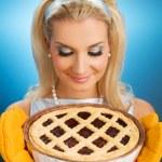 Beautiful woman holding hot italian pie — Stock Photo #2084129