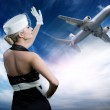Sexy stewardess and flying plane — Stock Photo #2084180