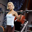 Strong woman lifting heavy weights - Stock Photo