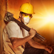 Builder with big metal hammer — Stock Photo