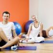 Group of relaxing after fitness exercise — Stock Photo