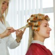 Hairdresser working in beauty salon — Stock Photo