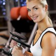 Strong woman lifting heavy weights — Stock Photo