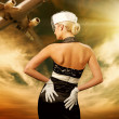 Sexy stewardess and flying plane — Stock Photo
