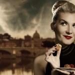 Beautiful young woman eating chocolate — Stock Photo