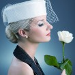 Beautiful young woman with white rose — Stock Photo