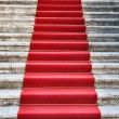 Ancient stairs covered with red carpet - 图库照片