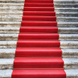 Ancient stairs covered with red carpet - Stockfoto