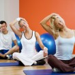 Group of doing yoga exercise — Stock Photo