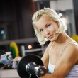 Strong woman lifting heavy weights — Stock Photo #2084963