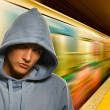 Young criminal in subway - Stock Photo