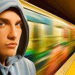 Young criminal in subway — Stock Photo