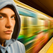 Young criminal in subway - Foto Stock