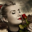 Beautiful young woman with red rose — Stock Photo