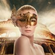 Beautiful woman in front of Colosseum - Stock Photo