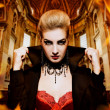 Stock Photo: Female vampire in burning church