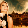 Woman drinking wine near the river — Stock Photo