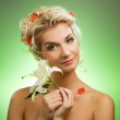 Beautiful young woman with lily flower — Stock Photo #2085252