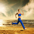 Young woman running on a beach — Stock Photo #2085318