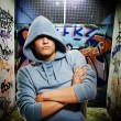 Hooligan in a graffiti painted gateway - Lizenzfreies Foto