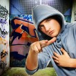 Hooligan in a graffiti painted gateway — Stock Photo #2085379