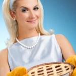 Beautiful woman holding hot italian pie — Stock Photo #2085595